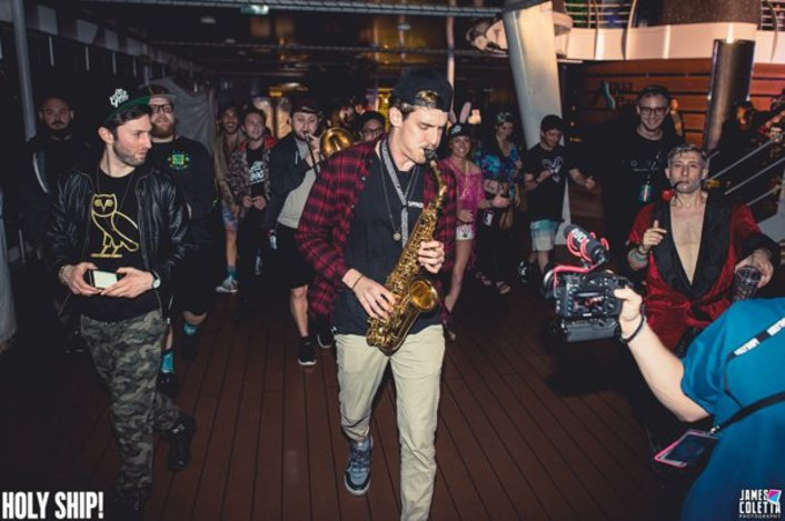 "GRiZ Plays ""Hotline Bling"" On Saxophone In Cafeteria At Holy Ship - Featured Image"
